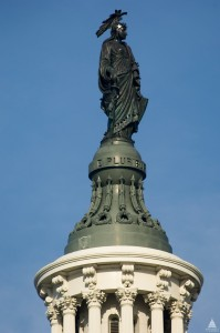 The Statue of Freedom stands high atop the Capitol Building in Washington D.C.